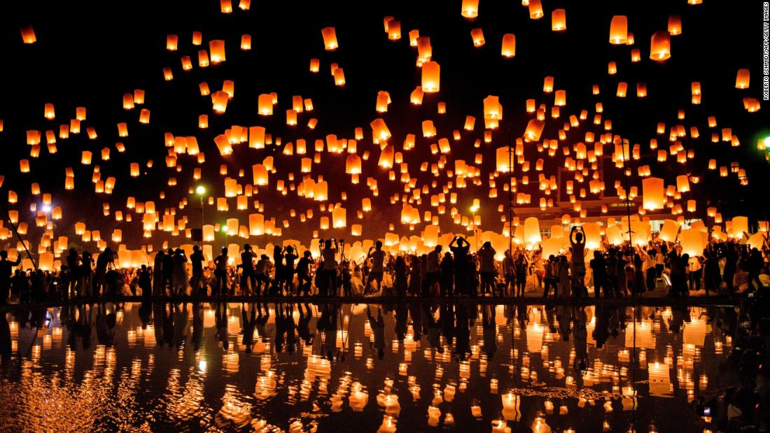 A crowd releases lanterns in the air to celebrate the Yee Peng festival, also known as the festival of lights, in Chiang Mai, Thailand, on Friday, November 3.