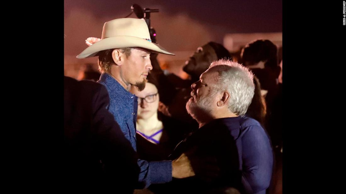 "Stephen Willeford, right, embraces Johnnie Langendorff at a vigil held Monday, November 6, for the victims of a <a href=""http://www.cnn.com/2017/11/05/us/gallery/sutherland-springs-church-shooting/index.html"" target=""_blank"">church shooting</a> in Sutherland Springs, Texas. The two men <a href=""http://www.cnn.com/2017/11/07/us/church-shooting-heroes-reunite-trnd/index.html"" target=""_blank"">pursued gunman Devin Patrick Kelley</a> in Langendorff's truck after Kelley opened fire in the church, killing at least 26 people. Willeford exchanged gunfire with Kelley, who eventually crashed into a ditch."