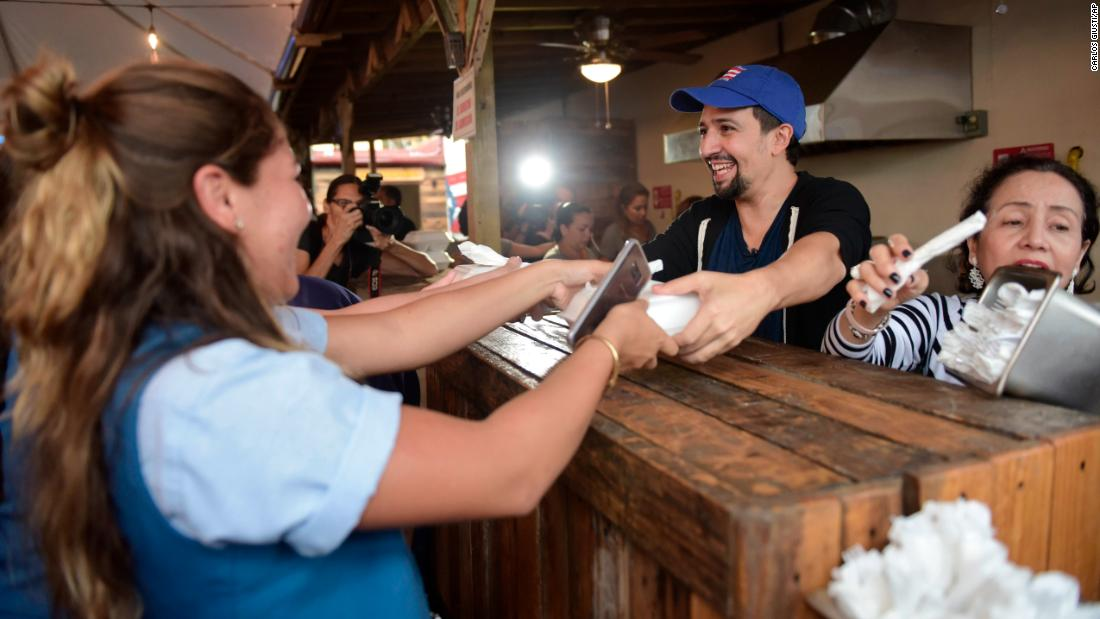 "Lin-Manuel Miranda, creator of the hit musical ""Hamilton,"" distributes food to <a href=""http://www.cnn.com/interactive/2017/09/world/hurricane-maria-puerto-rico-cnnphotos/"" target=""_blank"">Hurricane Maria victims</a> in Vega Alta, Puerto Rico, on Tuesday, November 7."