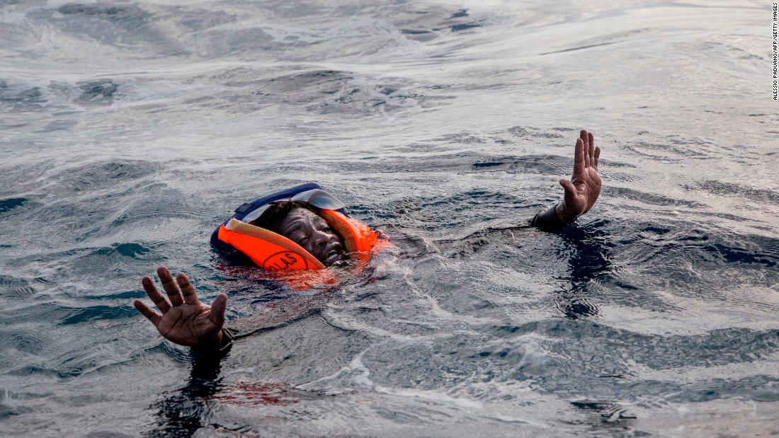 A migrant tries to board the boat of Sea-Watch, a German aid group, during a rescue operation in the Mediterranean Sea on Monday, November 6.