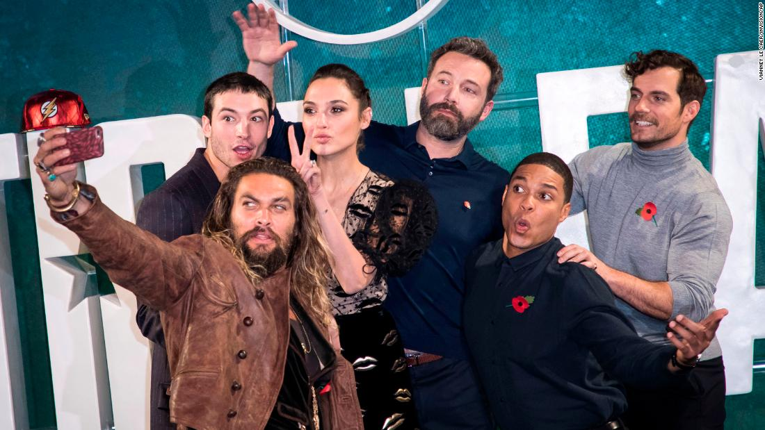 "Actor Jason Momoa takes a selfie with his ""Justice League"" co-stars in London on Saturday, November 3. With Momoa, from left, are Ezra Miller, Gal Gadot, Ben Affleck, Ray Fisher and Henry Cavill."