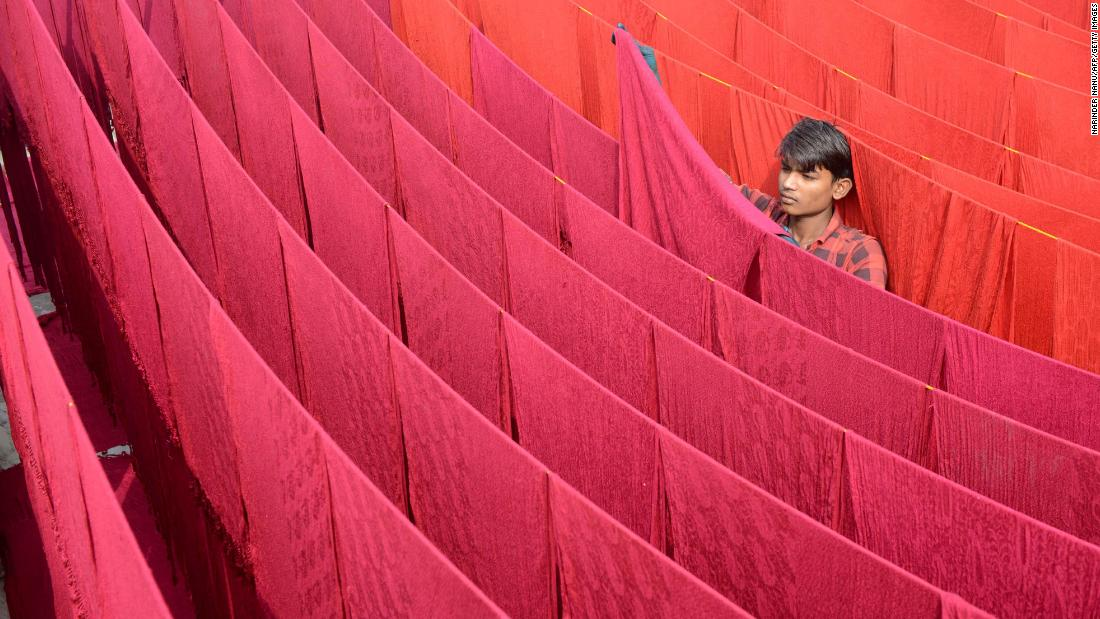 An artisan dries stoles after dyeing them in Amritsar, India, on Sunday, November 5.