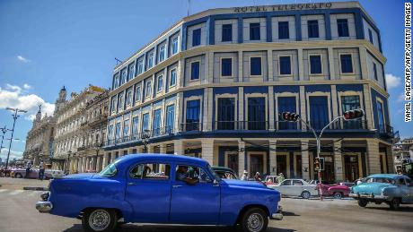 A car passes by the Telegrafo Hotel in Havana on November 8, 2017. Tighter restrictions on US travellers to Cuba will go into effect on Thursday, officials said, almost five months after President Donald Trump vowed to crack down. The US Treasury said the measures are designed to steer American travellers away from Cuban firms tied to the military and towards the communist island's fledgling private sector. / AFP PHOTO / Yamil LAGE        (Photo credit should read YAMIL LAGE/AFP/Getty Images)