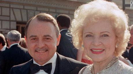 FILE- This Sept. 22, 1985, file photo shows John Hillerman, left, and Betty White, right, arriving at Emmy Awards in Pasadena, Calif. (AP Photo/LIU, File)