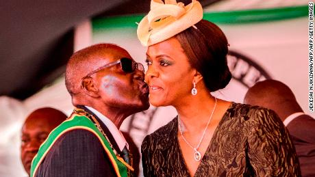 Robert Mugabe kisses his wife Grace during Independence Day celebrations in Harare this April.