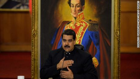 (FILES) This file photo taken on October 17, 2017 shows Venezuelan President Nicolas Maduro  during a press conference with international media correspondents at the Miraflores Presidential Palace in Caracas. The United States on November 9, 2017 unveiled fresh sanctions against the government of Venezuelan President Nicolas Maduro, targeting 10 officials over alleged corruption and interference in gubernatorial elections last month.The new sanctions come as EU member states prepare to impose an arms embargo on Venezuela, whose leftist government has sought to tighten its grip on power amid a prolonged economic and political crisis.  / AFP PHOTO / FEDERICO PARRAFEDERICO PARRA/AFP/Getty Images