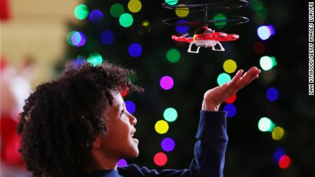LONDON, ENGLAND - NOVEMBER 08:  Zayne, 7, plays with a 'My First Drone' at a media event announcing the top 12 toys for christmas at St Mary's Church in Marylebone on November 8, 2017 in London, England. The Toy Retailers Association's Dream Toys chart, is an independent list of the predicted Christmas best-selling gifts for children.  (Photo by Dan Kitwood/Getty Images) *** BESTPIX ***