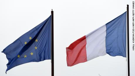 "A picture taken on November 10, 2017 shows a European Union flag (L) and a French flag (R) waving in the air at the French embassy in Moscow. French former director of the French Alliance in Irkutsk Yoann Barbereau sentenced in Russia and charged in 2015 for suspected wrongdoings of sexual nature on minors, arrived in Nantes on November 9, 2017. Barbereau was hidden ""for a more then a year"" at the French Embassy in Moscow, he declared on November 9, 2017 on French TV channel France 2, confirming press information. / AFP PHOTO / Kirill KUDRYAVTSEVKIRILL KUDRYAVTSEV/AFP/Getty Images"