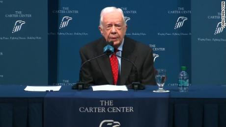 "Former President Jimmy Carter said Thursday doctors found four spots of melanoma on his brain, describing his cancer diagnosis at a press conference in Atlanta. ""I'll get my first radiation treatment this afternoon,"" Carter said, adding doctors began checking for more cancer after removing a spot from his liver."