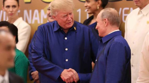 US President Donald Trump shakes hands with Russia's President Vladimir Putin at an APEC summit in Vietnam in November.