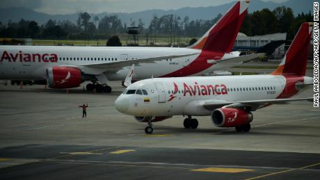 Planes of Colombia's Avianca Airline remain on the runway at El Dorado airport in Bogota, on July 27, 2017.  Avianca Airlines stopped flying to Venezuela today. / AFP PHOTO / Raul Arboleda        (Photo credit should read RAUL ARBOLEDA/AFP/Getty Images)