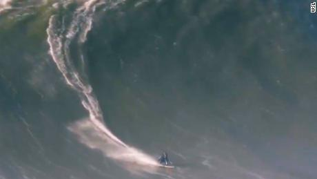 Surfer breaks back after massive wipeout