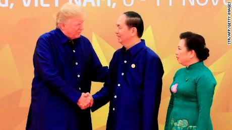 US President Donald Trump shakes hands with Vietnamese President Tran Dai Quang upon arrival for the Asia-Pacific Economic Cooperation (APEC) Summit