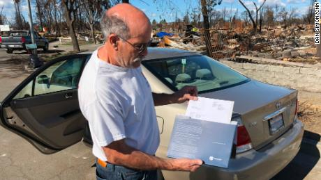 Coffey Park resident John Wimmer displays the newly arrived check from his insurance company.