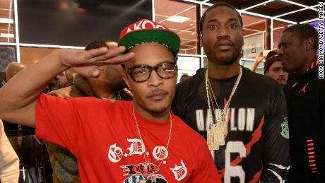 Meek Mill (right) with rapper T.I., who has urged people to compare Meek's sentencing to the lack of consequences most police officers face after episodes of police violence.