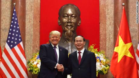 President Donald Trump, left, and Vietnamese President Tran Dai Quang shakes hands at the Presidential Palace, Sunday, Nov. 12, 2017, in Hanoi, Vietnam. Trump is on a five country trip through Asia traveling to Japan, South Korea, China, Vietnam and the Philippines. (AP Photo/Andrew Harnik)