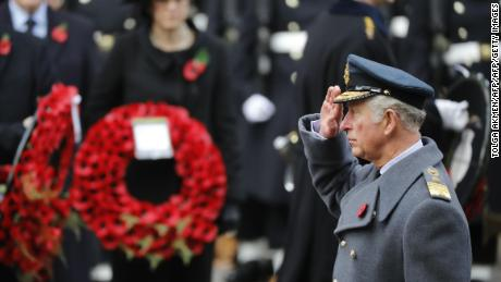 Prince Charles salutes during the Remembrance Sunday ceremony at the Cenotaph.