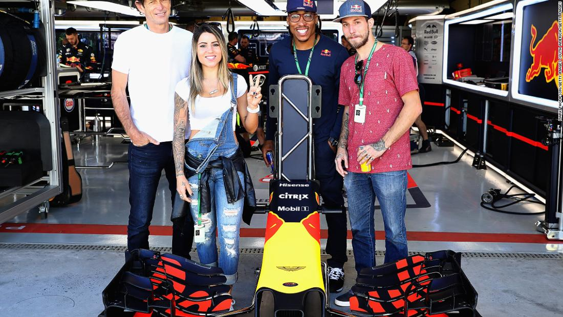 Skateboarder Leticia Bufoni, climber Felipe Camargo, Capoeira master Artur Fiu and TV superstar Felipe Titto pose for a photo outside the Red Bull Racing garage ahead of the race.