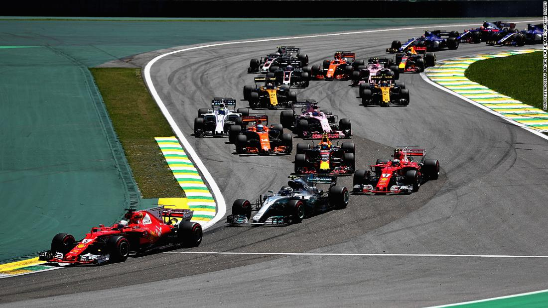 Vettel took the lead at the first corner, heading into the Senna Esses.