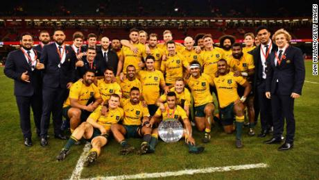 Australia pose for a photo after beating Wales in Cardiff