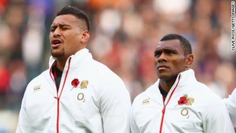Semesa Rokoduguni (right) and Nathan Hughes stand for the national anthems