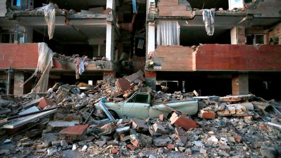 A crushed car is seen among the debris in Sarpol-e-Zahab on November 13.