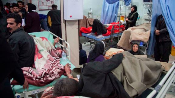 The injured receive treatment at a hospital in Sarpol-e Zahab on November 13.