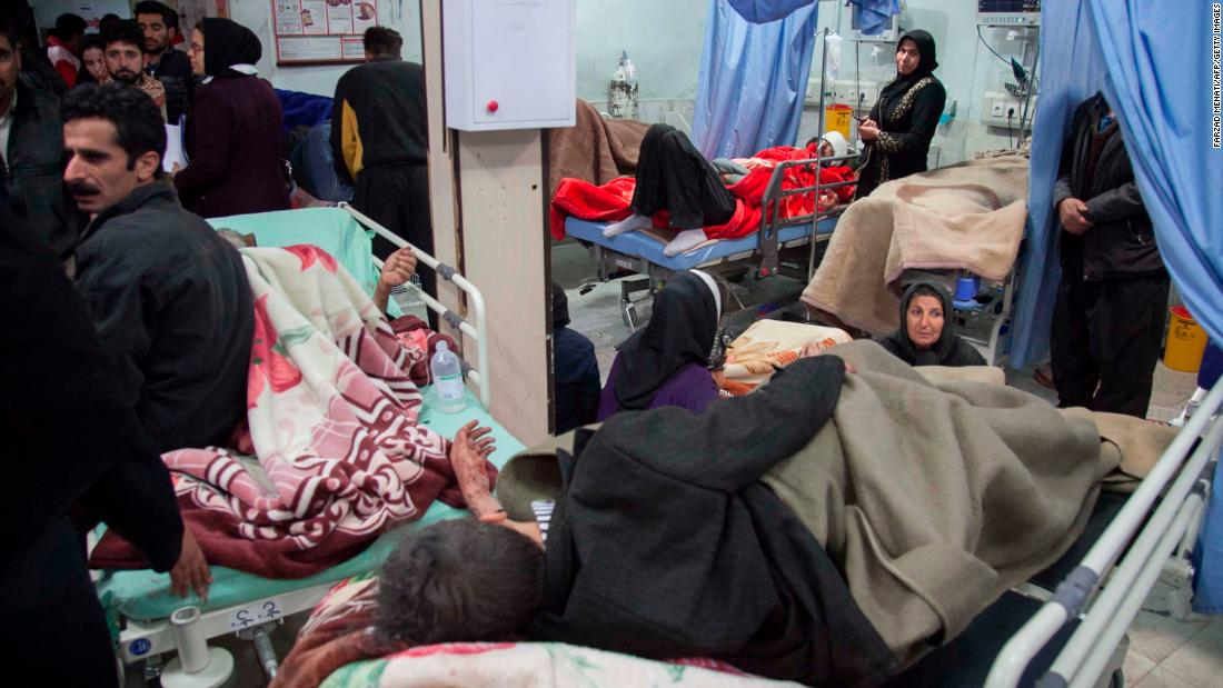 The injured receive treatment at a hospital in Sarpol-e Zahab on November 13.