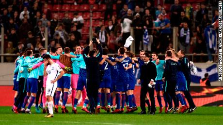 Croatia's team celebrates after winning the World Cup 2018 play-off football match Greece vs Croatia, on November 12, 2017 in Piraeus. / AFP PHOTO / ANGELOS TZORTZINIS        (Photo credit should read ANGELOS TZORTZINIS/AFP/Getty Images)
