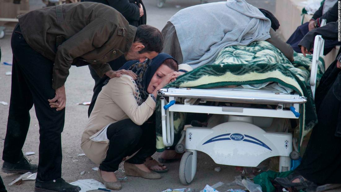 People mourn over the body of a quake victim in Sarpol-e Zahab on November 13.