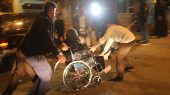 A wounded person is rushed to a hospital in Iraq's Sulaimaniya province on November 12.