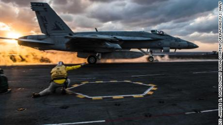 An F/A-18E Super Hornet launches from the flight deck of the USS Ronald Reagan.