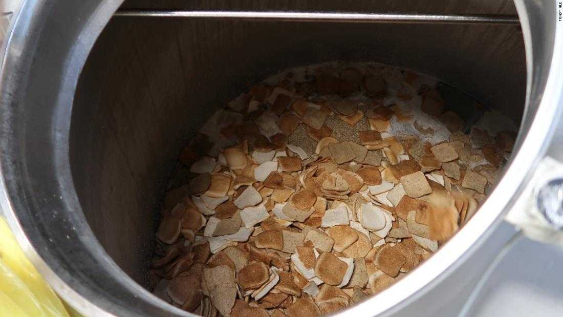 The bread is combined with malted barley, oat husks, and water. The mixture is heated in a process known as mashing.<br />