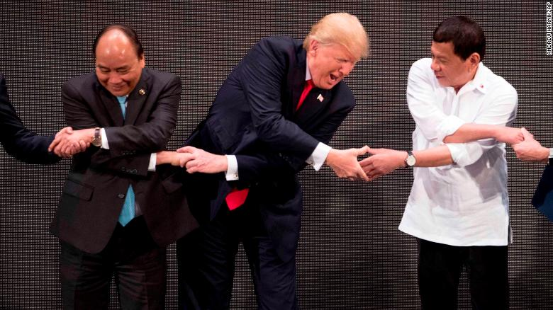 Trump joins world leaders for ASEAN handshake