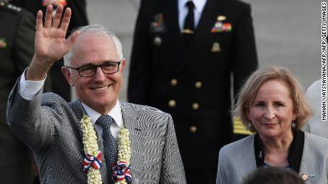 Australia Prime Minister Malcolm Turnbull (L) waves as his wife Lucy looks on upon arriving in the Philippines on November 12, 2017, for the ASEAN meeting.