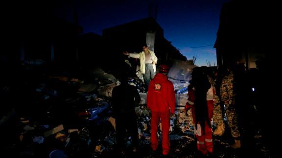 Rescue crews search through the rubble in Sarpol-e Zahab on November 13.