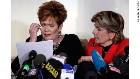 "Beverly Young Nelson, left, the latest accuser of Alabama Republican Roy Moore, reads her statement as attorney Gloria Allred looks on, at a news conference, in New York, Monday, Nov. 13, 2017. Nelson says Moore assaulted her when she was 16 and he offered her a ride home from a restaurant where she worked. Moore says the latest allegations against him are a ""witch hunt."" (AP Photo/Richard Drew)"