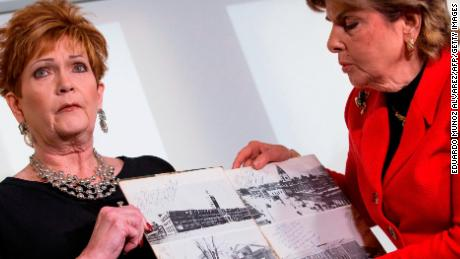 Attorney Gloria Allred (R) and Beverly Young Nelson hold up a picture showing a message and a signature of Roy Moore during a press conference on November 13, 2017, in New York, alledging that Roy Moore sexually assaulted Nelson when she was a minor in Alabama without her consent. The US Senate's top Republican on Monday urged scandal-hit conservative Roy Moore to end his Senate campaign,  saying he believes the women who have accused the Christian evangelical candidate of sexual misconduct. / AFP PHOTO / EDUARDO MUNOZ ALVAREZ        (Photo credit should read EDUARDO MUNOZ ALVAREZ/AFP/Getty Images)
