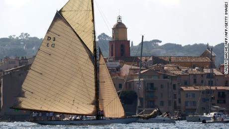"A yacht is sailed by crewmembers off the coast of the southern French city of Saint Tropez on October 4, 2017, part of the yearly ""Les Voiles de Saint-Tropez"".  Some one hundred yachts will take part in sailing regattas in the bay of Saint-Tropez during the festival.  / AFP PHOTO / VALERY HACHE        (Photo credit should read VALERY HACHE/AFP/Getty Images)"