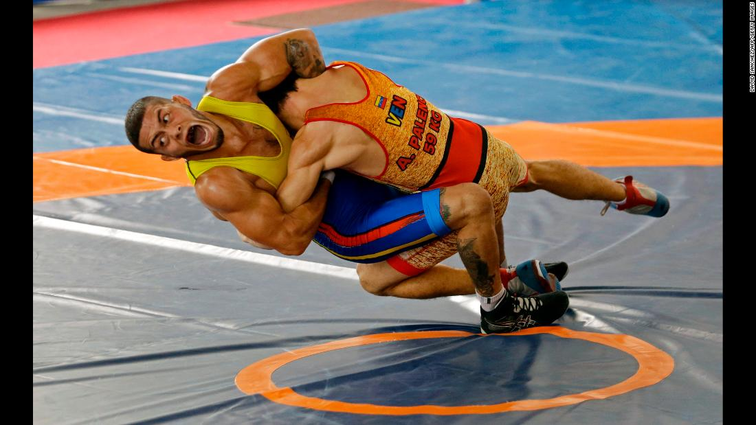 Colombian wrestler Dicter Toro, left, competes against Venezuela's Anthony Palencia during the annual Bolivarian Games on Sunday, November 12. This year's events are taking place in Santa Marta, Colombia.