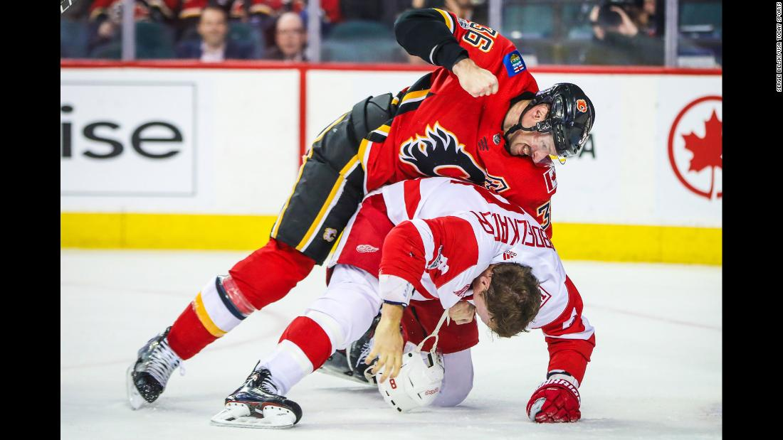 Calgary's Troy Brouwer, top, fights Detroit's Justin Abdelkader during an NHL game in Calgary, Alberta, on Thursday, November 9.
