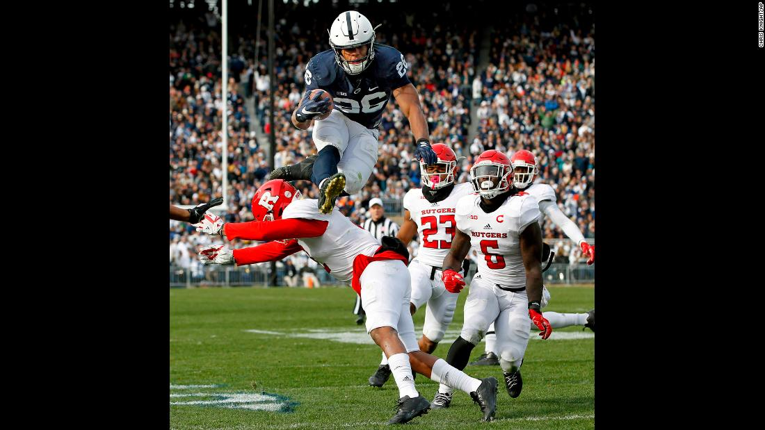 Penn State running back Saquon Barkley hurdles a Rutgers player during a college football game in State College, Pennsylvania, on Saturday, November 11. Barkley had two touchdowns in his team's 35-6 victory.