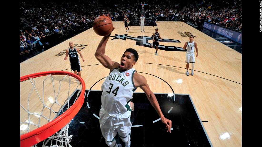 Milwaukee forward Giannis Antetokounmpo dunks the ball during an NBA game in San Antonio on Friday, November 10. He had 28 points in the Bucks' 94-87 victory, and as of Monday he leads the league in scoring (31.7 points per game).