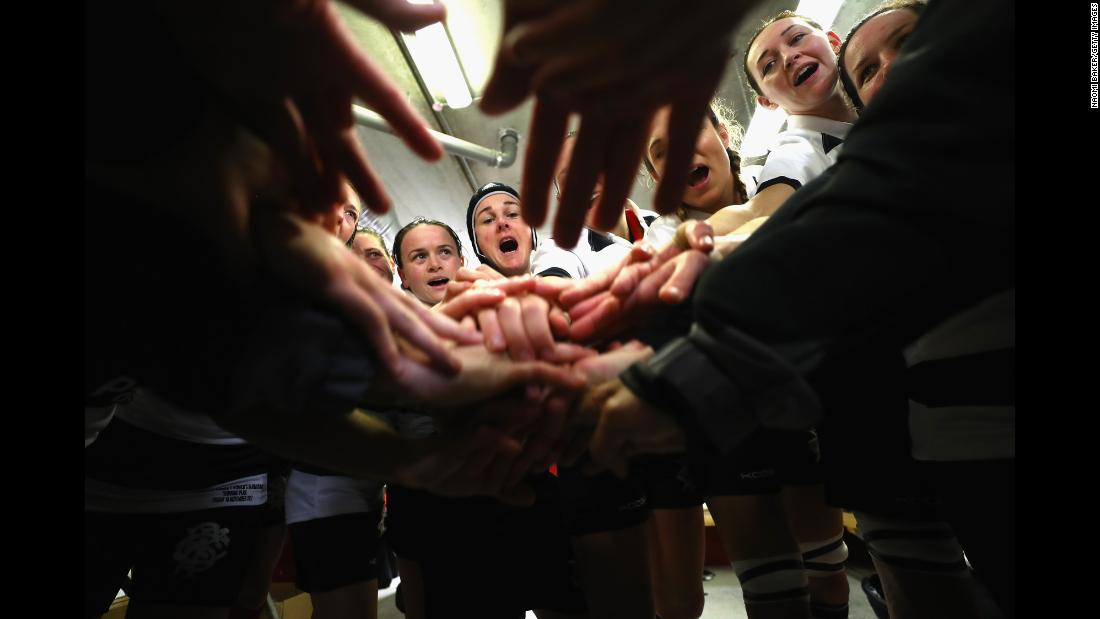 The Barbarians women, an invitational rugby team made up of some of the world's best players, huddle in the dressing room before their inaugural match in Limerick, Ireland, on Friday, November 10. The Barbarians men's team has been around since the 19th century.