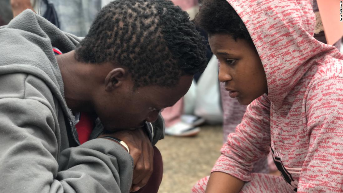 Another woman tearfully says goodbye to her husband as she must also leave the country alone.