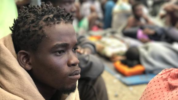 Migrants held at the government-run detention centers say that while they are provided with some food, they are often still hungry and thirsty.
