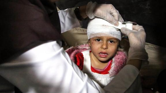 A wounded child receives medical treatment at a hospital in Sarpol-e Zahab on Monday, November 13.
