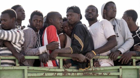 A picture taken on June 27, 2017 shows illegal immigrants being transported to a detention centre in the Libyan coastal town of Zawiyah, 45 kilometres west of the capital Tripoli, after their rescue while attempting to reach Europe. / AFP PHOTO / Taha JAWASHI        (Photo credit should read TAHA JAWASHI/AFP/Getty Images)