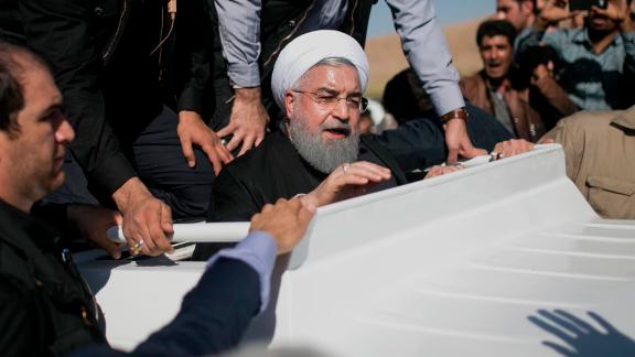 Iranian President Hassan Rouhani, center, visits those affected by the quake in Sarpol-e Zahab on November 14.
