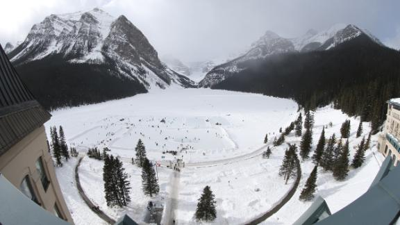 An annual ice hockey tournament takes place on the frozen lake outside the Chateau Lake Louise.